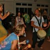 People Drumming and Dancing